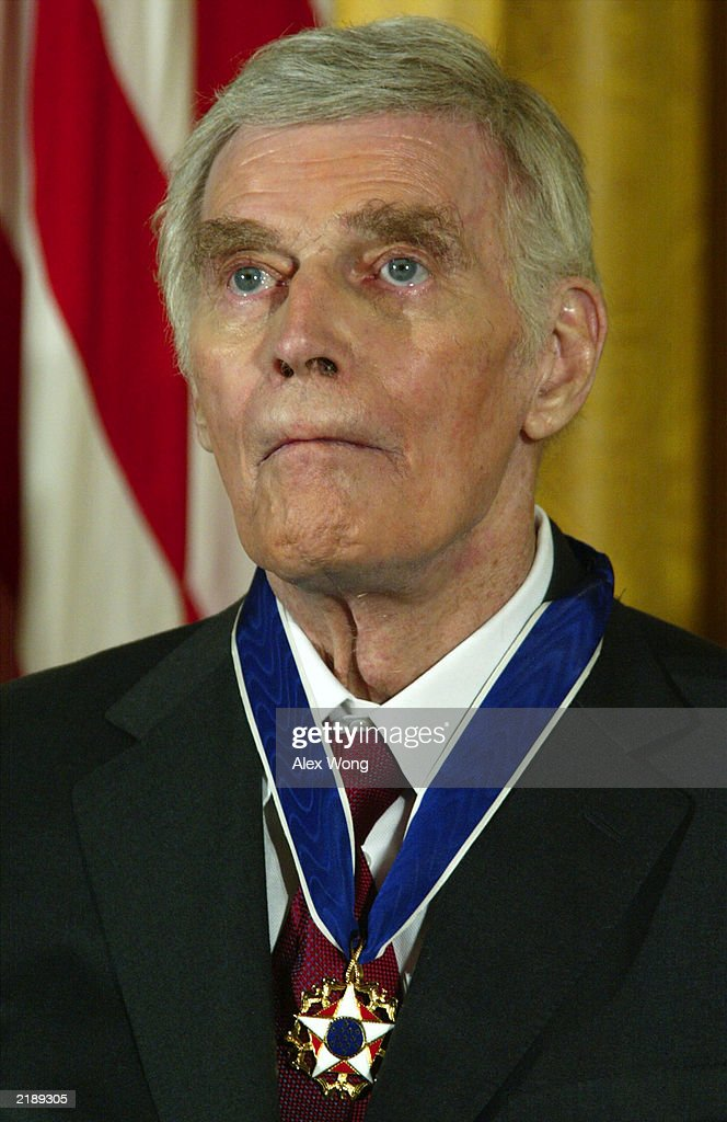 Former actor <a gi-track='captionPersonalityLinkClicked' href=/galleries/search?phrase=Charlton+Heston&family=editorial&specificpeople=123834 ng-click='$event.stopPropagation()'>Charlton Heston</a> wears the Presidential Medal of Freedom after being honored by U.S. President George W. Bush during an East Room event at the White House July 23, 2003 in Washington, DC. Heston was honored for a lifetime of achievement as an actor and citizen.