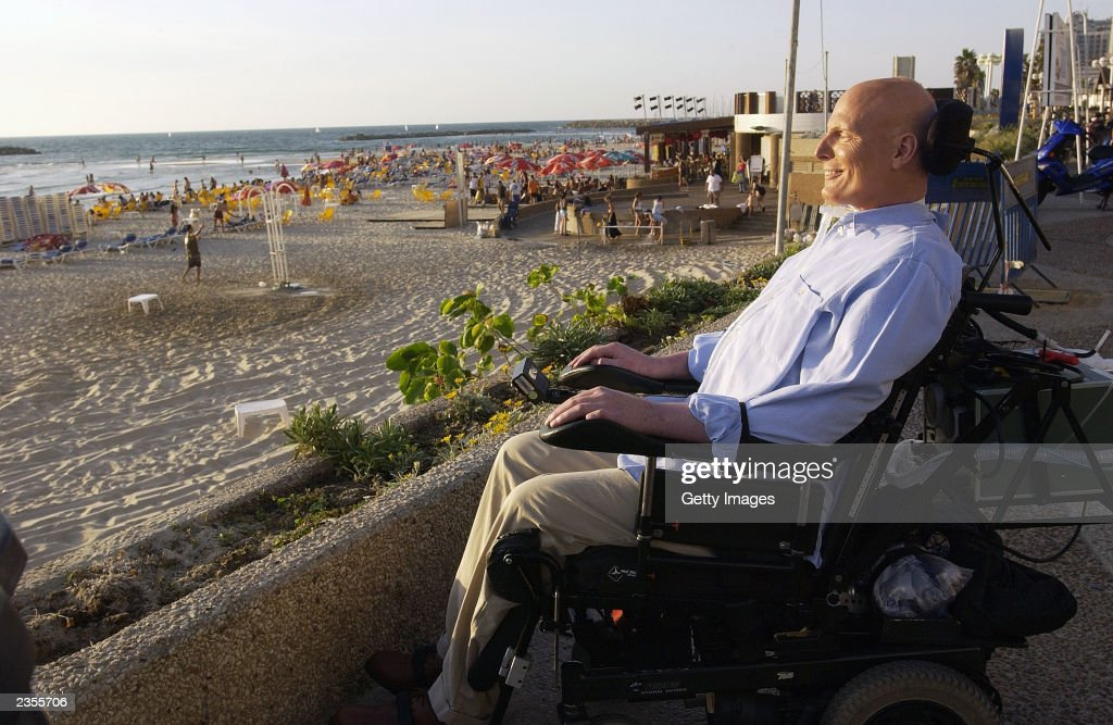 Former actor Christopher Reeve enjoys a quiet moment on the promenade overlooking the Mediterranean Sea August 1, 2003 in Tel Aviv, Israel. Reeve is on a four-day visit to Israel.