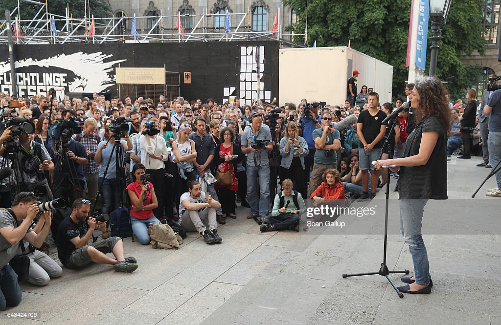 Former actress and now refugee May Skaf performs in front of an outdoor audience in front of the Gorki theater as part of the conclusion of the latest artist/activist event by the Center for Political Beauty (Zentrum fuer Politische Schoenheit) on June 28, 2016 in Berlin, Germany. The event, called 'Devour Refugees', is meant to bring attention to the plight of refugees seeking to reach Europe. The activsts had contracted a passenger plane to bring 100 Syrian refugees from Turkey to Germany, though the flight was reportedly cancelled today. For the last two weeks the activists have maintained a cage with tigers outside the theater as part of the conceptual piece.