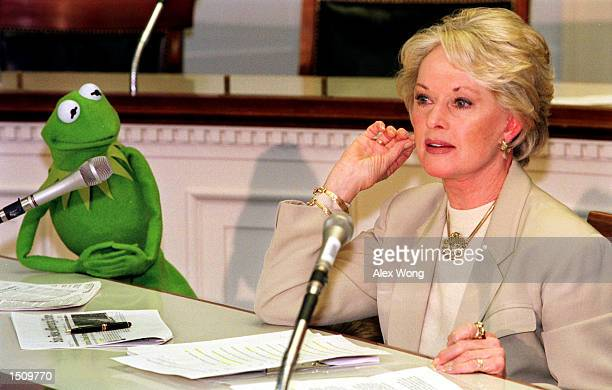 Former actress Tippi Hedren right speaks as Kermit the Frog looks on during a press conference on Capitol Hill in Washington DC March 29 2000...