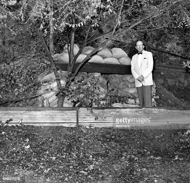 Former AEC Commissioner Libby who also worked on the Manhattan Project designed and built the shelter for $30 using bags filled with dirt and...