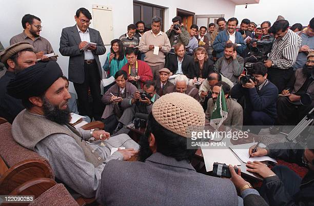 Former Afghan Prime Minister Gulbuddin Hekmatyar take part in a press conference 13 February 1996 in Islamabad after talks with other Afghan...