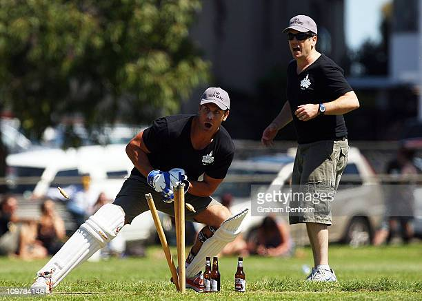 Former AFL player Wayne Carey of team The Vineyard stumps his opponent during the 'Batting for the Battlers' Celebrity Charity Cricket Match at...