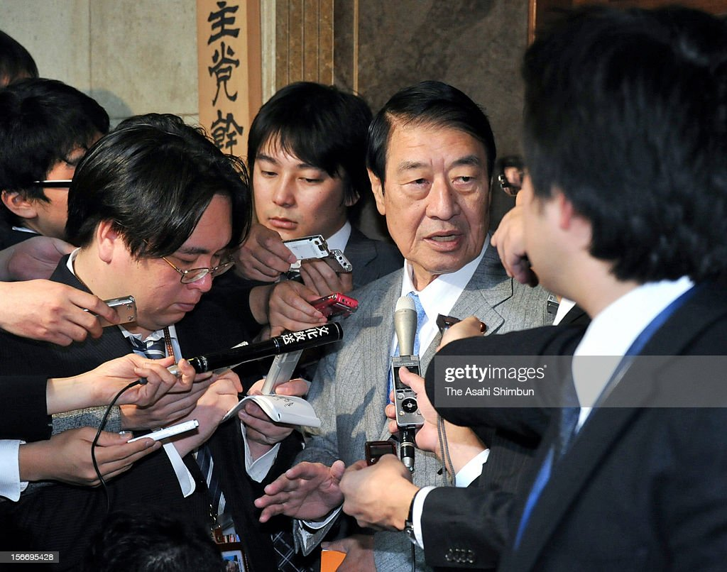 Former Agriculture Minister Masahiko Yamada speaks to the reporters after submiting the party resignation letters on November 19, 2012 in Tokyo, Japan. As former Environment Minister Sakihito Ozawa also left, the number of resigned lawmakers from ruling Democratic Party of Japan reached 12. Yamada will form a new party with lawmaker Shizuka Kamei.
