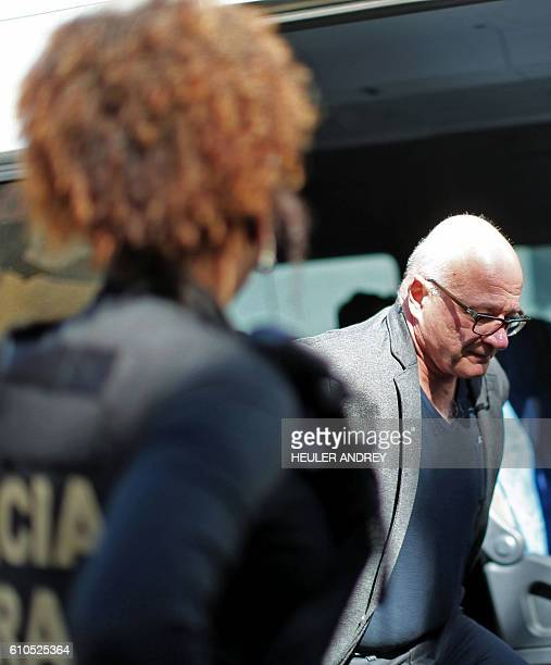 A former aide to Brazilian former Finance Minister Antonio Palocci Branislav Kontic is pictured upon arriving under police escort at the Forensic...
