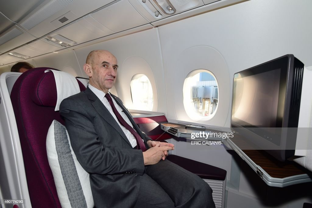 Former Airbus CEO <a gi-track='captionPersonalityLinkClicked' href=/galleries/search?phrase=Louis+Gallois&family=editorial&specificpeople=752096 ng-click='$event.stopPropagation()'>Louis Gallois</a> sits aboard an A350 during an hour flight over France on December 22, 2014. Airbus delivered its first next-generation A350-900 plane to Qatar Airways Monday in a formal ceremony that kickstarts its bid to erode rival Boeing's dominance in the lucrative long-haul market. AFP PHOTO / ERIC CABANIS