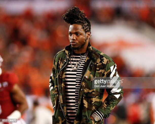 Former Alabama Crimson Tide running back and Heisman Trophy winner Derrick Henry stands on the field prior to the 2017 College Football Playoff...