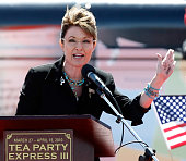 Former Alaska Gov Sarah Palin jokes about having writing on her hand as she speaks at the Tea Party Express' 'Showdown in Searchlight' rally March 27...