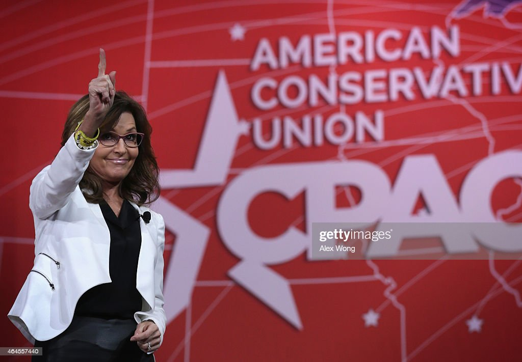 Former Alaska Governor <a gi-track='captionPersonalityLinkClicked' href=/galleries/search?phrase=Sarah+Palin&family=editorial&specificpeople=4170348 ng-click='$event.stopPropagation()'>Sarah Palin</a> acknowledges the crowd after she addressed the 42nd annual Conservative Political Action Conference (CPAC) February 26, 2015 in National Harbor, Maryland. Conservative activists attended the annual political conference to discuss their agenda.