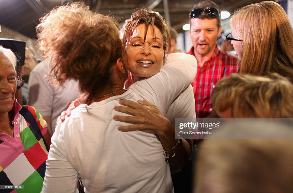 Former Alaska Governor Sarah Palin embraces a fairgoer while visiting the Cattle Barn at the Iowa State Fair August 12, 2011 in Des Moines, Iowa. Although she has not announced any intention of running for president, all of the Republican presidential hopefuls are visiting the fair ahead of Saturday's Iowa Straw Poll to greet voters and engage in traditional Iowa campaigning rituals.