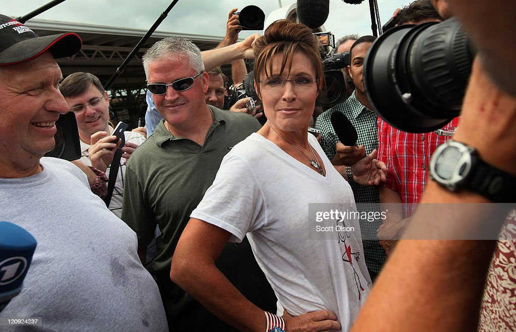 Former Alaska Governor <a gi-track='captionPersonalityLinkClicked' href=/galleries/search?phrase=Sarah+Palin&family=editorial&specificpeople=4170348 ng-click='$event.stopPropagation()'>Sarah Palin</a> greets visitors at the Iowa State Fair August 12, 2011 in Des Moines, Iowa. Palin joined most of the declared Republican presidential hopefuls who are visiting the fair ahead of tomorrow's Iowa Straw Poll to greet voters and engage in the traditional Iowa campaigning ritual.