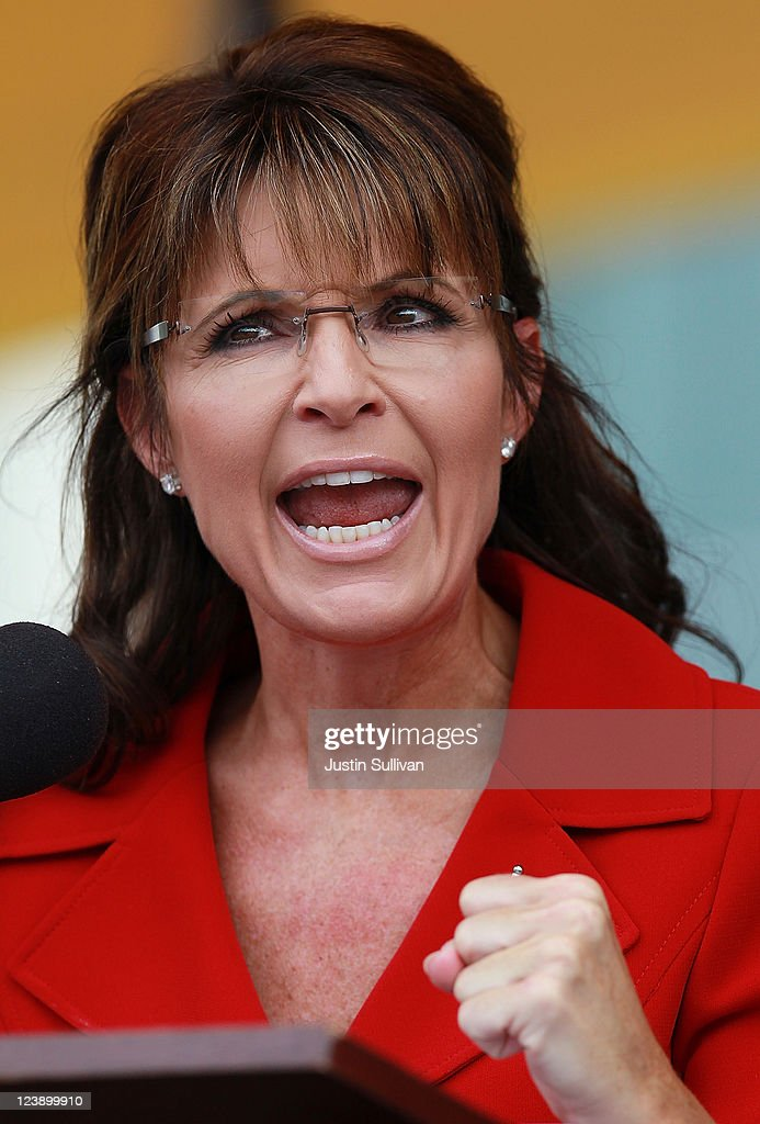 Former Alaska governor <a gi-track='captionPersonalityLinkClicked' href=/galleries/search?phrase=Sarah+Palin&family=editorial&specificpeople=4170348 ng-click='$event.stopPropagation()'>Sarah Palin</a> speaks during a Tea Party Express rally on September 5, 2011 in Manchester, New Hampshire. Hundreds of people attended the rally that is part of the 'Reclaiming America' bus tour traveling through 19 states and visiting 29 cities before arriving in Tampa, Florida for a presidential debate co-sponsored by CNN on September 12.
