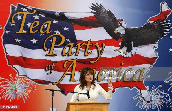 Former Alaska governor Sarah Palin speaks during the Tea Party of America's 'Restoring America' event at the Indianola Balloon Festival Grounds on...