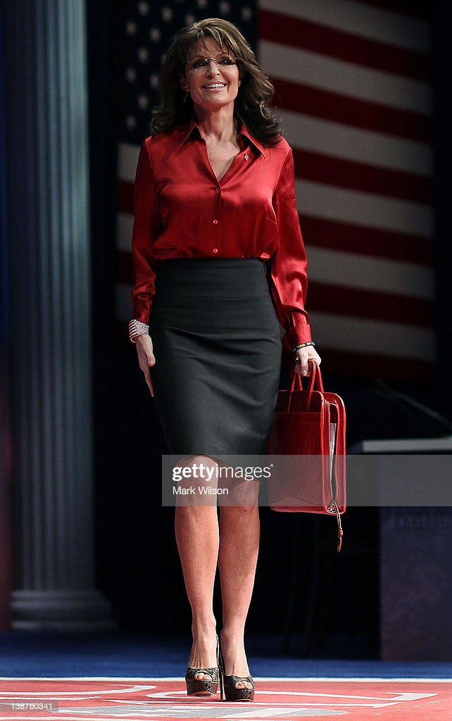 Former Alaska Governor, <a gi-track='captionPersonalityLinkClicked' href=/galleries/search?phrase=Sarah+Palin&family=editorial&specificpeople=4170348 ng-click='$event.stopPropagation()'>Sarah Palin</a> walks onstage to address the Conservative Political Action Conference (CPAC), at the Marriott Wardman Park Hotel, on February 11, 2012 in Washington, DC. Thousands of conservative activists are attending the three day annual gathering in the nation's capital.