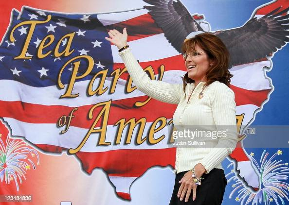 Former Alaska governor Sarah Palin waves to the crowd before speaking during the Tea Party of America's 'Restoring America' event at the Indianola...