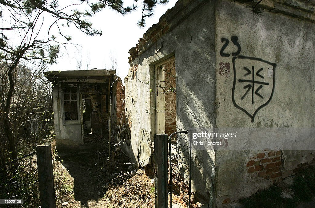 A former Albanian house sits, torched and marked with Serbian grafitti, March 14, 2007 on the Serbian side of Mitrovica, Kosovo. Before 1999 Mitrovica was a town where Serbs and ethnic Albanians lived side-by-side. It is now is Kosovo's most glaring symbol of separation, as the two populations quickly separated themselves after the fall of the Serbian government in Kosovo and occupied opposite banks of the Ibar river.
