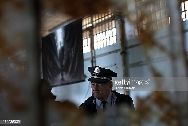 Former Alcatraz Island prison guard Jim Albright looks on while viewing an exhibit of photographs documenting the last day of Alcatraz federal...