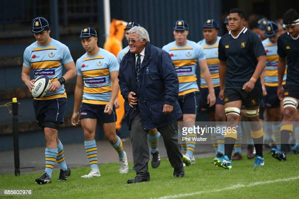 Former All Black Bryan Williams leads out the teams before the schoolboy First XV rugby match between Mt Albert Grammar and Auckland Grammar at Mt...