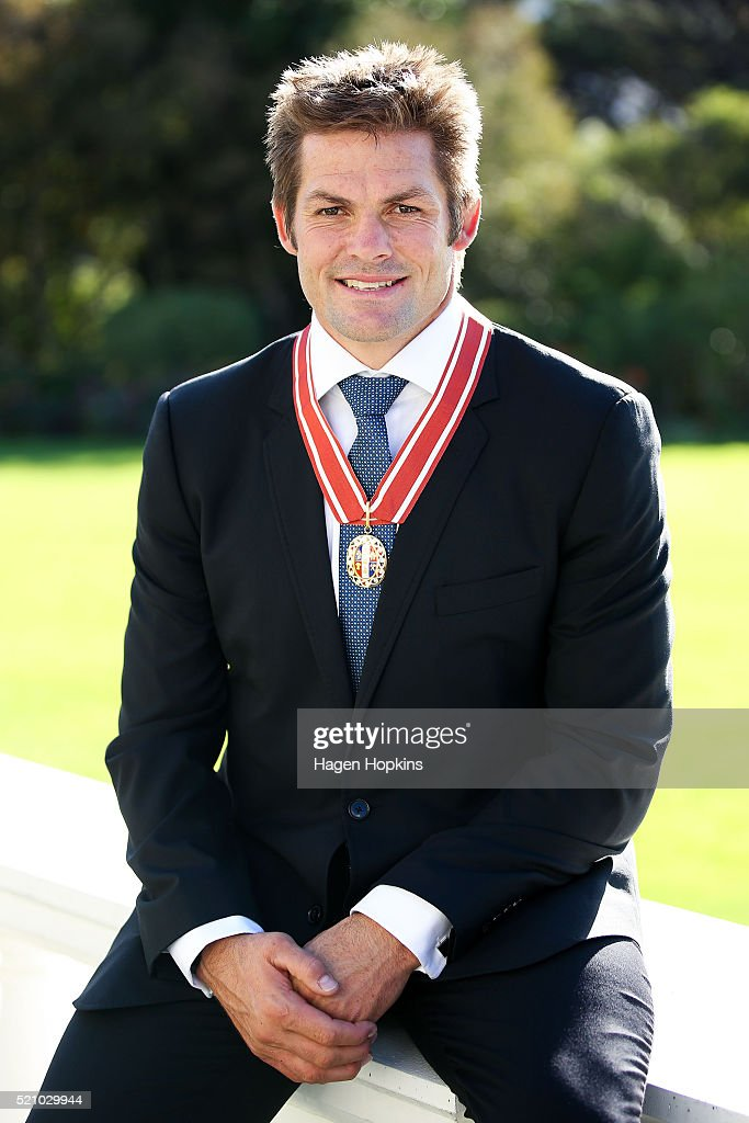 Former All Black captain Richie McCaw poses after receiving the insignia of a Member of the Order of New Zealand for services to New Zealand during...