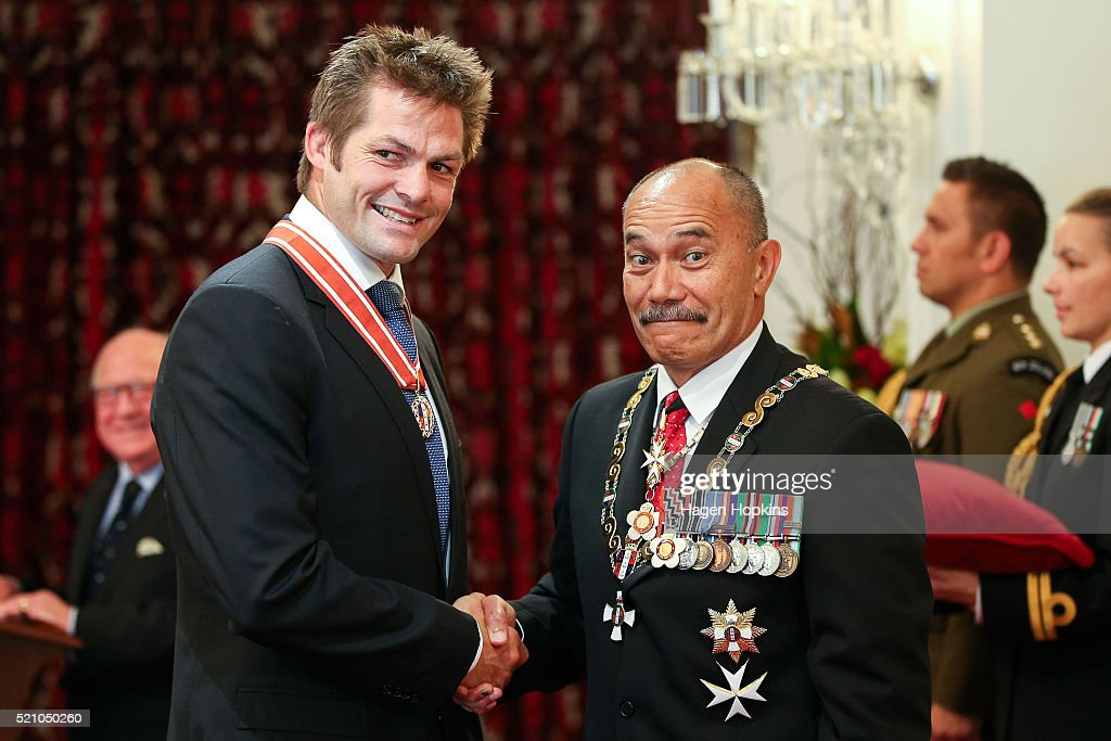 Former All Black captain Richie McCaw receives the insignia of a Member of the Order of New Zealand from Governor-General Sir Jerry Mateparae for services to New Zealand during an investiture ceremony at Government House on April 14, 2016 in Wellington, New Zealand. The Governor-General holds investiture ceremonies twice a year in Wellington and Auckland for the people named in the New Year and Queen's Birthday honours lists.