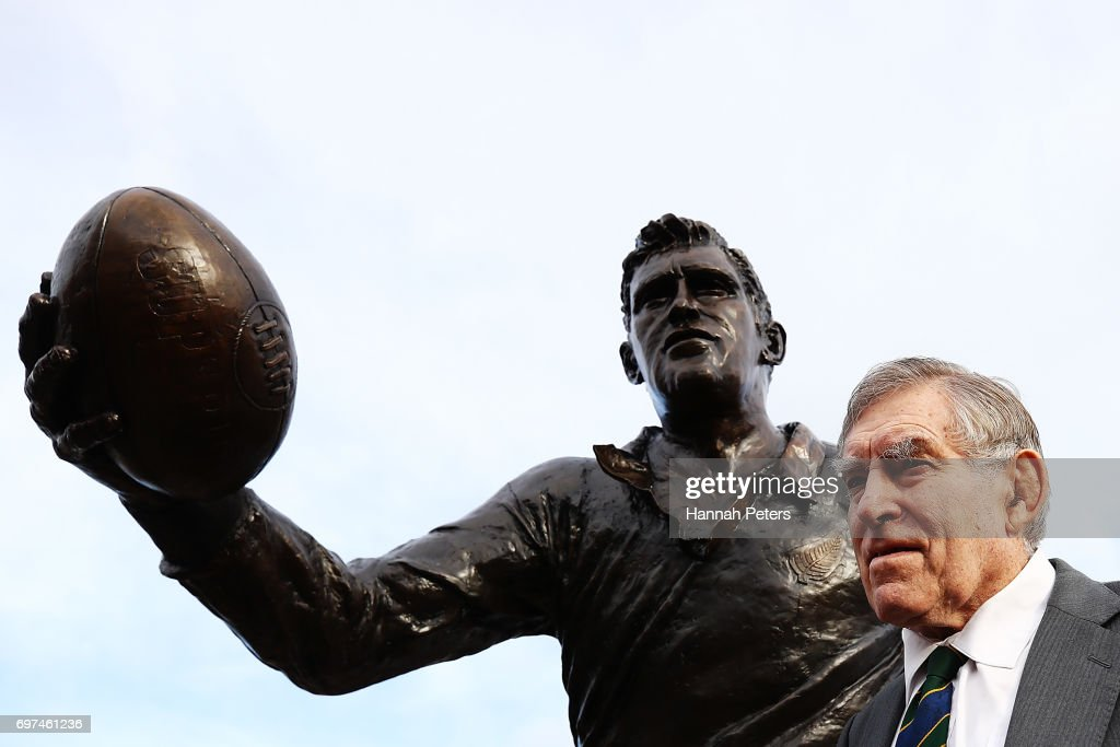 Former All Blacks player Sir Colin Meads is seen in front of a new statue of himself on June 19, 2017 in Te Kuiti, New Zealand. The 1.5 x life size bronze sculpture has been designed and made by Auckland artist Natalie Stamilla.