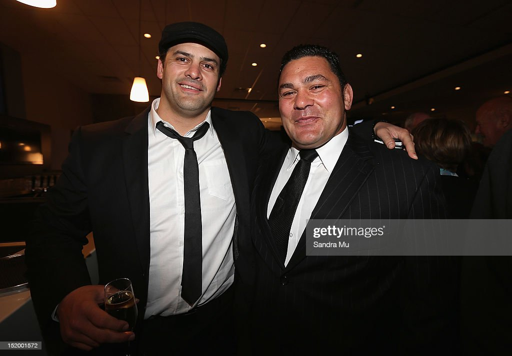 Former All Blacks Ron Cribb (L) and Kees Meeuws pose during the New Zealand All Blacks reunion dinner on September 14, 2012 in Dunedin, New Zealand.