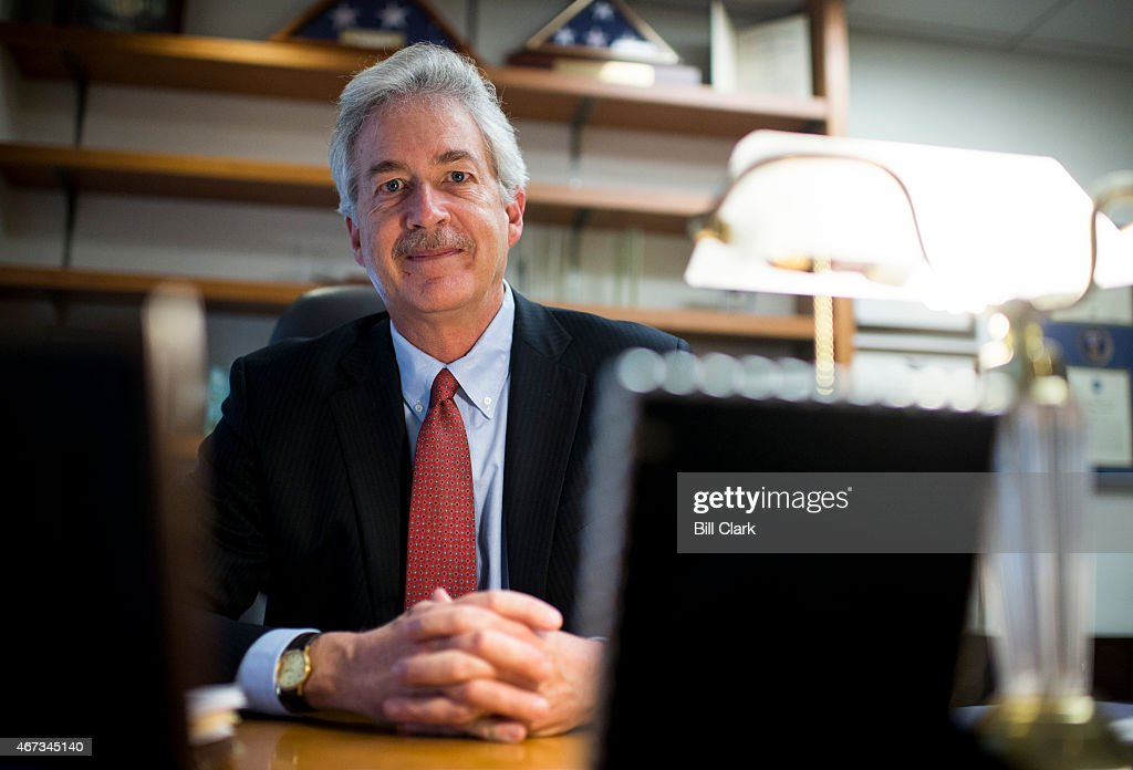 Former Ambassador William Burns, president of the Carnegie Endowment for International Peace, poses at his desk in Washington on Friday, March 20, 2015.