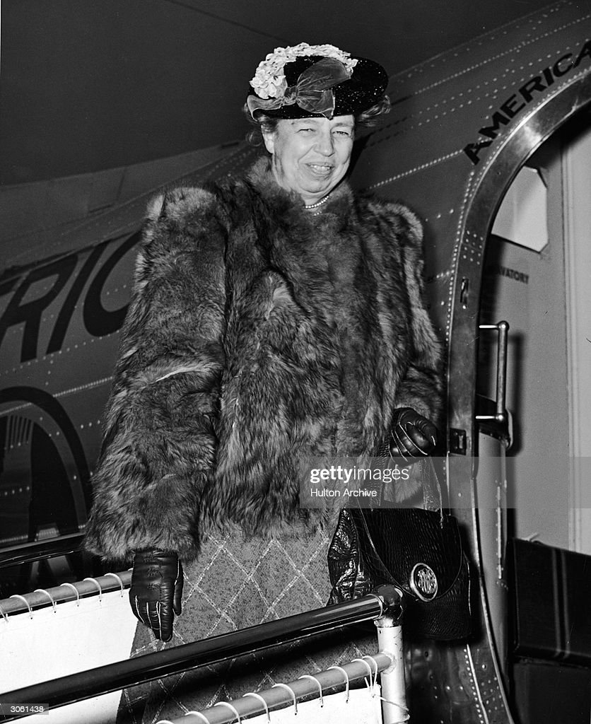 Former American First Lady and diplomat <a gi-track='captionPersonalityLinkClicked' href=/galleries/search?phrase=Eleanor+Roosevelt&family=editorial&specificpeople=93348 ng-click='$event.stopPropagation()'>Eleanor Roosevelt</a> (1884 - 1962) smiles while boarding a plane, wearing a fur coat, early 1950s.