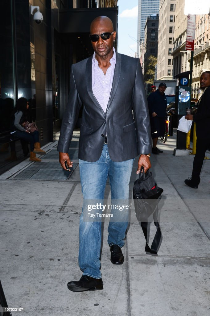 Former American football player <a gi-track='captionPersonalityLinkClicked' href=/galleries/search?phrase=Jerry+Rice&family=editorial&specificpeople=184559 ng-click='$event.stopPropagation()'>Jerry Rice</a> leaves his Midtown Manhattan hotel on April 26, 2013 in New York City.