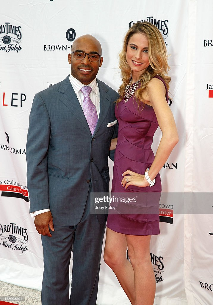 Former American football player Tiki Barber and his wife Traci Lynn Johnson attend the Julep Ball 2013 during the 139th Kentucky Derby at KFC YUM! Center on May 3, 2013 in Louisville, Kentucky.