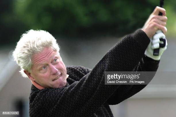 Former American President Bill Clinton plays off the second tee at the Old Course at the Royal and Ancient Golf Club in St Andrews Scotland * Mr...