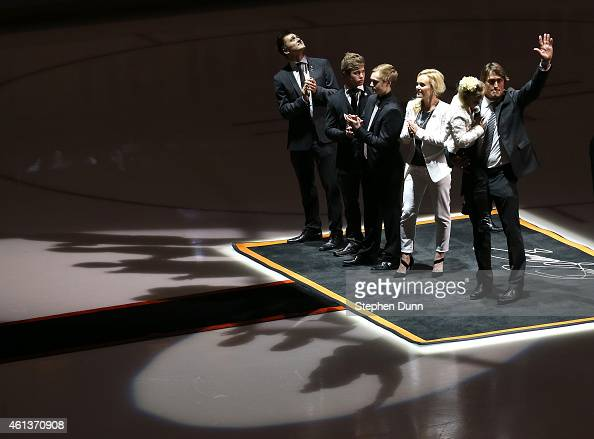 Former Anaheim Ducks star Teemu Selanne waves as he stands with wife Sirpa and sons Eemil Eetu and Leevi and holds daughter Veera after the raising...