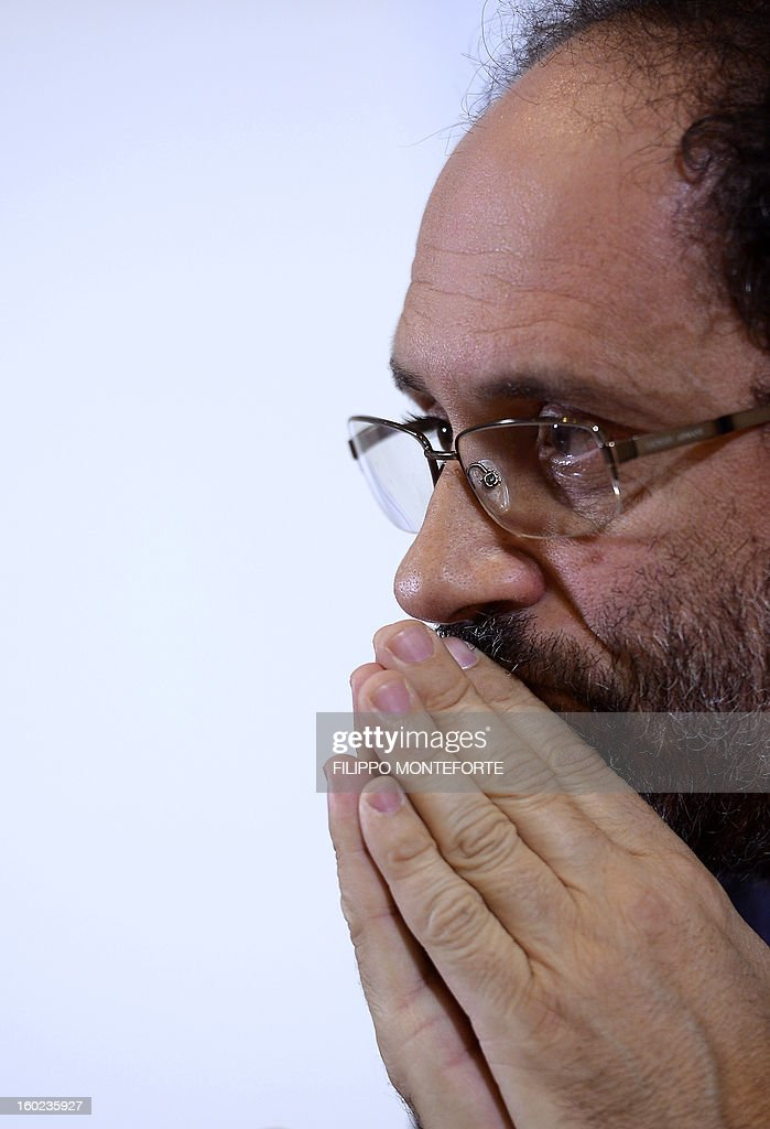 Former anti-mafia magistrate Antonio Ingroia, campaigning at the head of the separate left-wing coalition 'Rivoluzione Civica' (civic revolution), listens during a press conference at the foreign press club on January 28, 2013 in Rome. AFP PHOTO/ Filippo MONTEFORTE