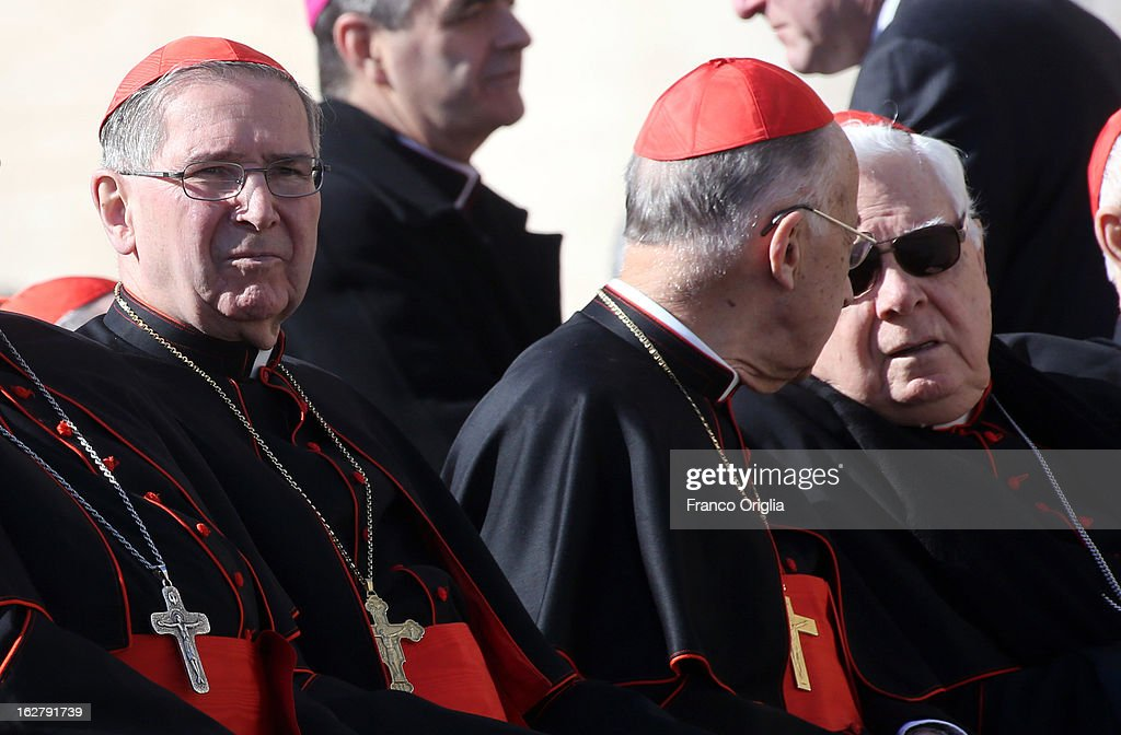 Former archbishop of Los Angeles cardinal <a gi-track='captionPersonalityLinkClicked' href=/galleries/search?phrase=Roger+Mahony&family=editorial&specificpeople=664416 ng-click='$event.stopPropagation()'>Roger Mahony</a> (L) and former Archbishop of Boston cardinal <a gi-track='captionPersonalityLinkClicked' href=/galleries/search?phrase=Bernard+Law&family=editorial&specificpeople=214089 ng-click='$event.stopPropagation()'>Bernard Law</a> (R) attend the Pope Benedict XVI's final general audience in St. Peter's Square on February 27, 2013 in Vatican City, Vatican. The Pontiff attended his last weekly public audience before stepping down tomorrow. Pope Benedict XVI has been the leader of the Catholic Church for eight years and is the first Pope to retire since 1415. He cites ailing health as his reason for retirement and will spend the rest of his life in solitude away from public engagements.
