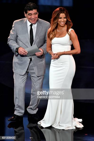 Former Argentine football player Diego Maradona and cohost and US actress Eva Longoria speak on stage to announce The Best FIFA Mens Player of 2016...