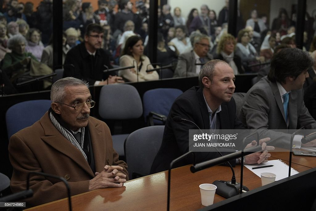 Former Argentine intelligence agent Miguel Angel Furci (L) gestures as he waits to hear the sentence to be handed down by the court in the trial on Operation Condor, in which six South American dictatorships collaborated to torture and kill their opponents, in Buenos Aires on May 27, 2016. South American ex-military leaders faced judgment Friday for their alleged role in the torture and assassination of leftist dissidents during a US-backed crackdown by the region's dictatorships during the 1970s and 1980s. Argentine judges were considering their verdict in the trial of 18 former army officers accused of taking part in 'Operation Condor.' In that scheme, the military regimes of Argentina, Bolivia, Brazil, Chile, Paraguay and Uruguay helped each other track down and kill leftist dissidents. On Friday, the court convened to deliver its verdict after a three-year trial -- the first to try the crimes committed under the Condor plan / AFP / JUAN
