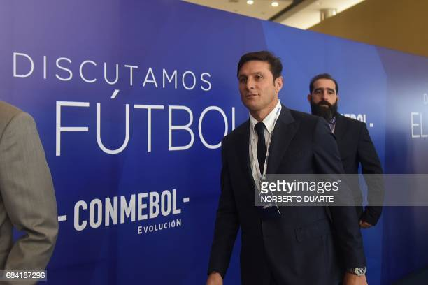 Former Argentine player Javier Zanetti arrives at the Conmebol headquarters in Luque Paraguay on May 17 2017 to participate in a meeting to discuss...