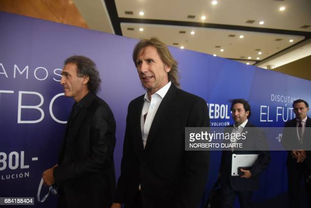 Former Argentine players Oscar Ruggeri and Ricardo Gareca arrive at the Conmebol headquarters in Luque Paraguay on May 17 2017 to participate in a...