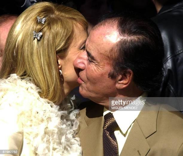 Former Argentine president Carlos Menem kisses his bride the Chilean former Miss Universe Cecilia Bolocco following their civil wedding ceremony 26...