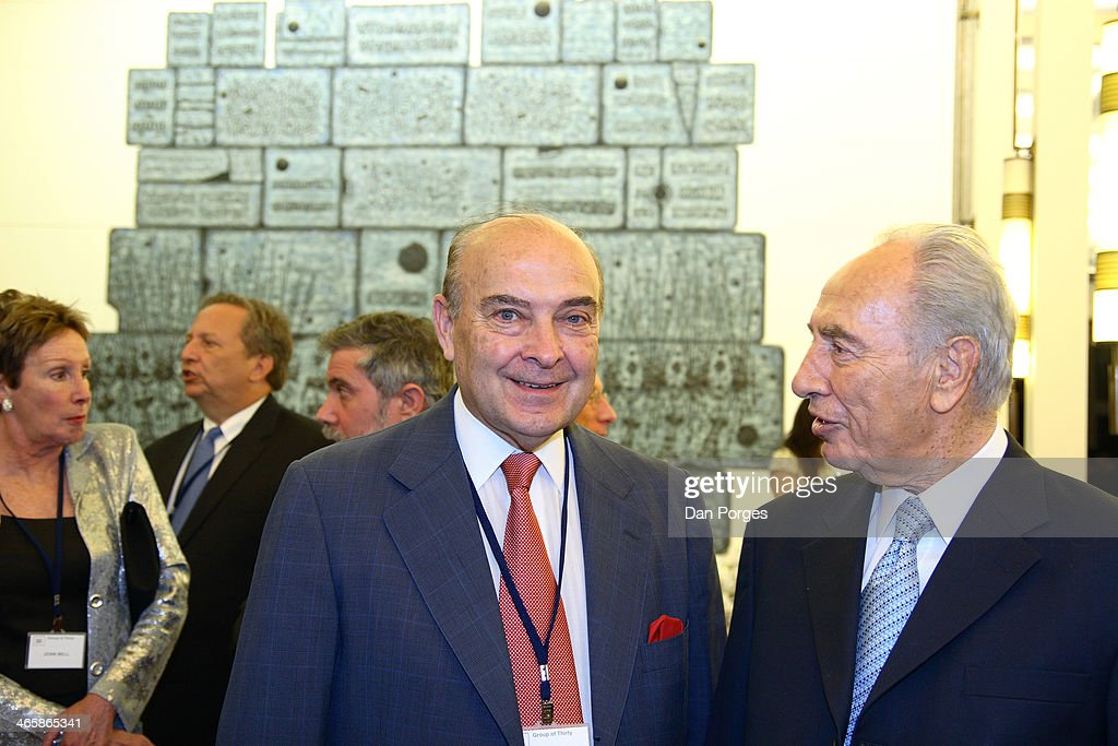 Former Argentinean Finance Minister Domingo Cavallo poses with President of Israel Shimon Peres during a conference of the Group of Thirty hosted by...