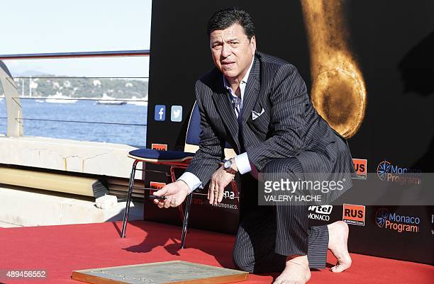 Former Argentinian defender Daniel Passarella writes his name during the Foot Print Ceremony as part of the 2015 Golden Foot Award ceremony in Monaco...