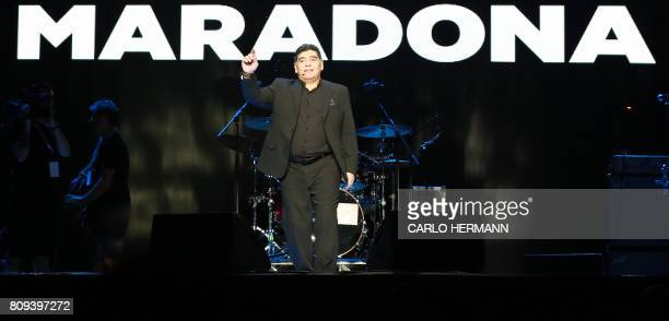 Former Argentinian football player Diego Armando Maradona gestures on stage as he acknowledges the audience during a show at Plebiscito Square in...