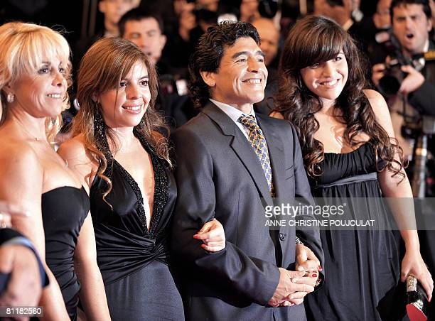 Former Argentinian football player Diego Maradona arrives with his wife Claudia and daughters Dalma and Giannina to attend the screening of Serbian...