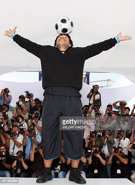 Former Argentinian football player Diego Maradona controls the ball as he poses during a photocall for Serbian director Emir Kusturica's film...