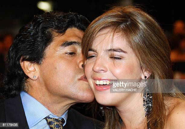 Former Argentinian football player Diego Maradona kisses his daughter Dalma as he arrives to attend the screening of Serbian director Emir...