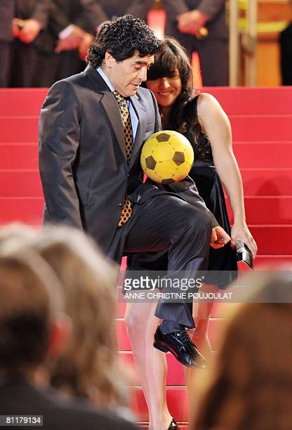 Former Argentinian football player Diego Maradona plays ball next to his daughter Giannina as he arrives to attend the screening of Serbian director...