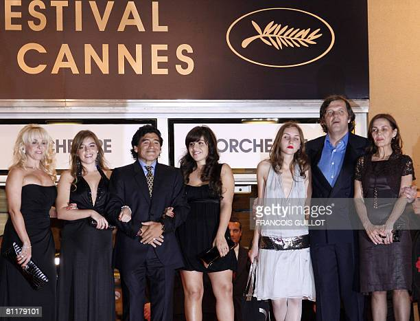 Former Argentinian football player Diego Maradona poses as he arrives with his wife Claudia and daughters Dalma and Giannina Serbian director Emir...