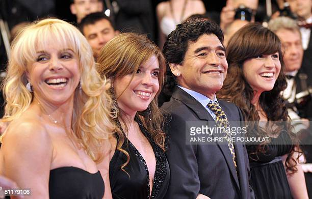 Former Argentinian football player Diego Maradona poses as he arrives with his wife Claudia and daughters Dalma and Giannina to attend the screening...