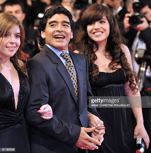 Former Argentinian football player Diego Maradona poses with hisdaughters Dalma and Giannina as they arrive to attend the screening of Serbian...