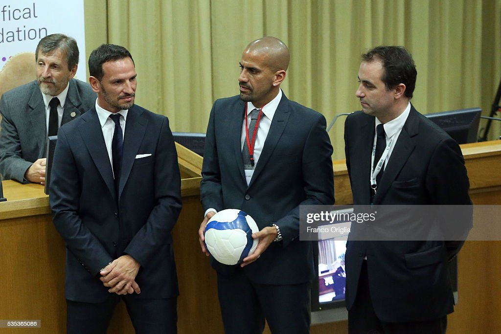 Former Argentinian football players Juan Sebastian Veron (C) and Abel Balbo (R) attend 'Un Muro o Un Ponte' Seminary held by Pope Francis at the Paul VI Hall on May 29, 2016 in Vatican City, Vatican.
